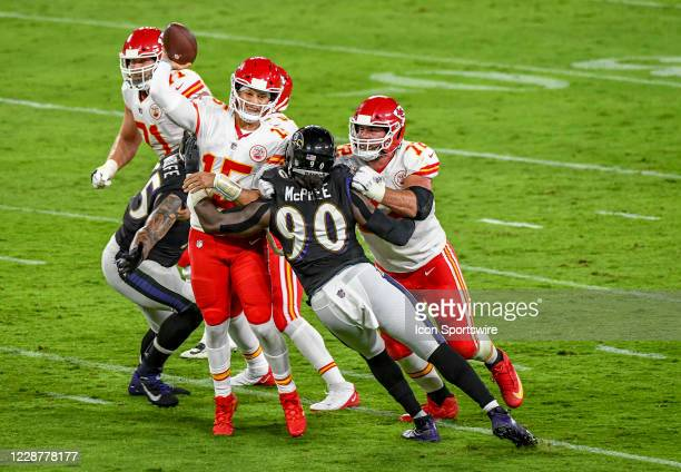 Kansas City Chiefs quarterback Patrick Mahomes passes under pressure from Baltimore Ravens outside linebacker Pernell McPhee and defensive end Derek...