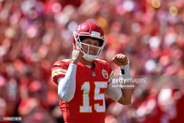 Kansas City Chiefs quarterback Patrick Mahomes raises his arms as he celebrates after throwing for a touchdown in game action during a NFL game...