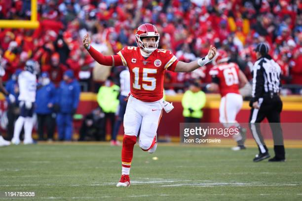 Kansas City Chiefs quarterback Patrick Mahomes raises his arms in celebration after completing a 20yard touchdown pass to wide receiver Tyreek Hill...
