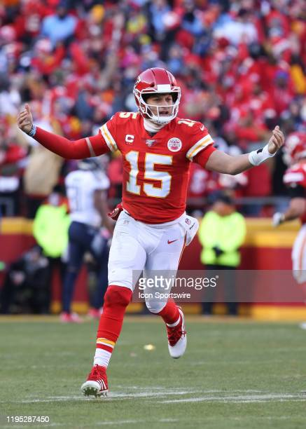 Kansas City Chiefs quarterback Patrick Mahomes raises his arms in celebration after completing a 20-yard touchdown pass to wide receiver Tyreek Hill...