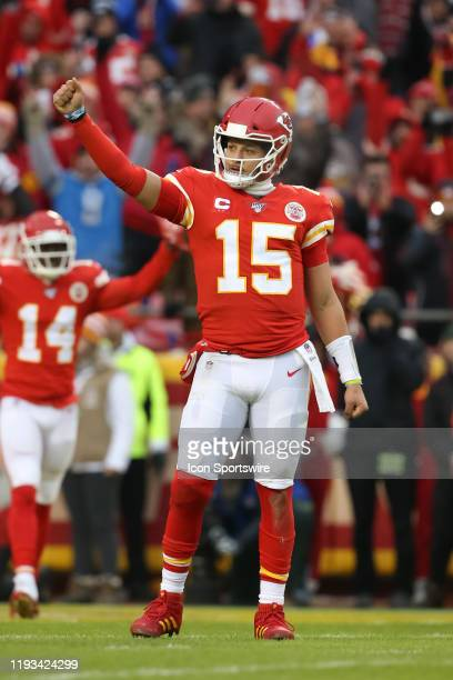 Kansas City Chiefs quarterback Patrick Mahomes raises his fist in celebration after running back Damien Williams scored from 1yard out early in the...