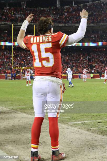 Kansas City Chiefs quarterback Patrick Mahomes raises his hands in celebration late in the fourth quarter of an AFC Divisional Round playoff game...