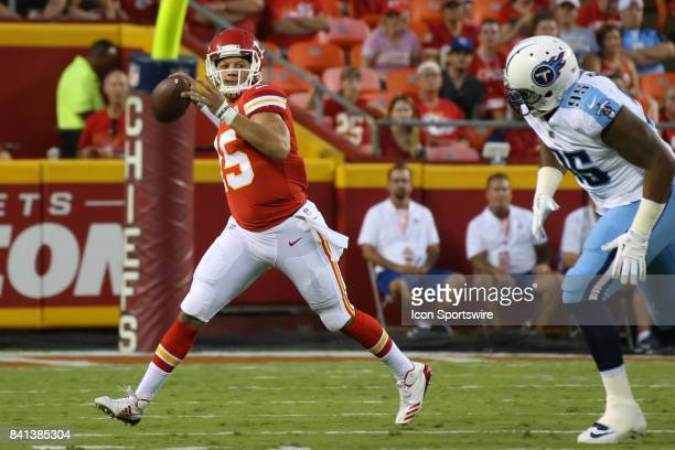 Kansas City Chiefs quarterback Patrick Mahomes rolls out away from Tennessee Titans defensive end Angelo Blackson in the first half of an NFL...