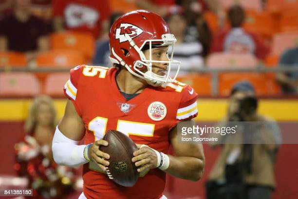 Kansas City Chiefs quarterback Patrick Mahomes rolls out before throwing a 46yard completion in the second quarter of an NFL preseason game between...