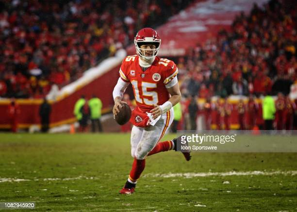 Kansas City Chiefs quarterback Patrick Mahomes rolls out during a 4-yard touchdown run with 1:40 left in the second quarter of an AFC Divisional...