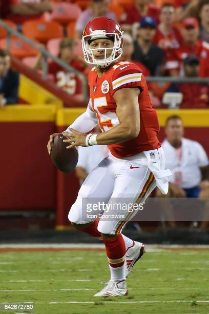Kansas City Chiefs quarterback Patrick Mahomes rolls out in the first half of an NFL preseason game between the Tennessee Titans and the Kansas City...