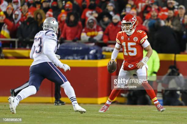 Kansas City Chiefs quarterback Patrick Mahomes rolls out to avoid pressure by New England Patriots middle linebacker Kyle Van Noy on 3rd and 2 with...