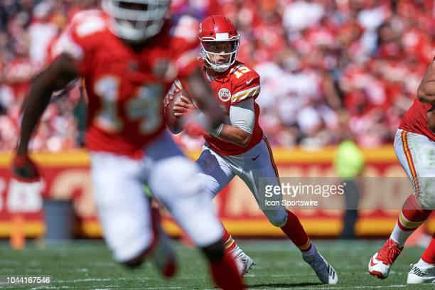 Kansas City Chiefs quarterback Patrick Mahomes runs with the football in action during an NFL game between the San Francisco 49ers and the Kansas...