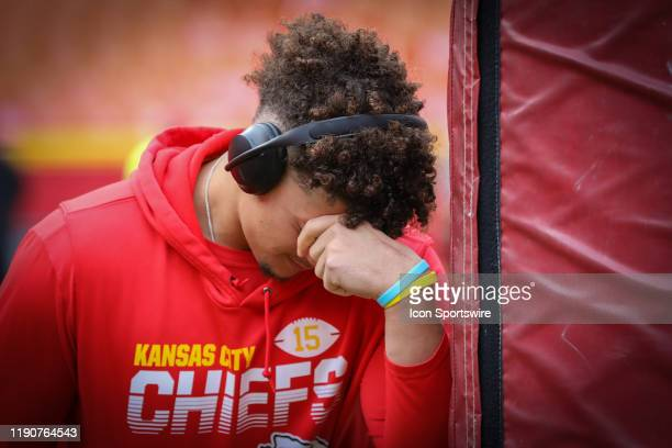 Kansas City Chiefs quarterback Patrick Mahomes says a prayer as he leans against the goalpost before an AFC West game between the Los Angeles...