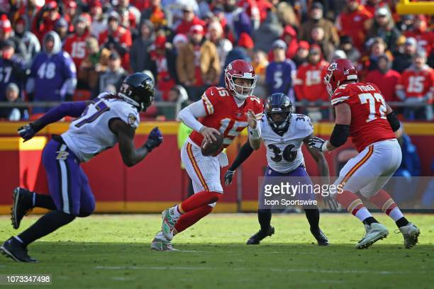 Kansas City Chiefs quarterback Patrick Mahomes scrambles before finding running back Spencer Ware for a 31yard completion with 106 left in the second...