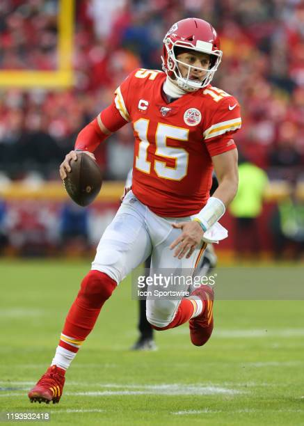 Kansas City Chiefs quarterback Patrick Mahomes scrambles for a 14-yard gain with 1:05 left in the second quarter of an NFL Divisional round playoff...