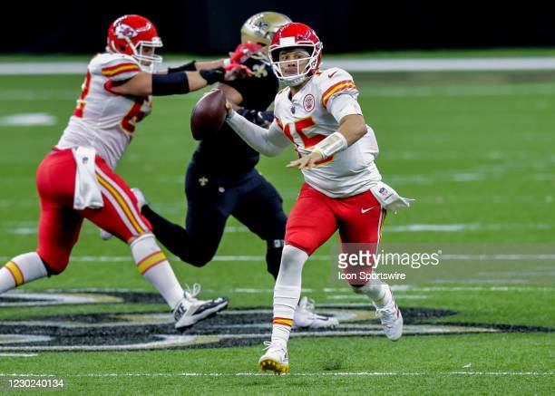 Kansas City Chiefs quarterback Patrick Mahomes scrambles to pass the ball against New Orleans Saints on December 20, 2020 at the Mercedes-Benz...