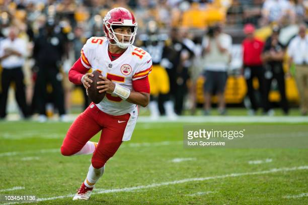 Kansas City Chiefs quarterback Patrick Mahomes scrambles with the ball during the NFL football game between the Kansas City Chiefs and Pittsburgh...