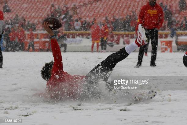 Kansas City Chiefs quarterback Patrick Mahomes slides in the snow before an AFC West game between the Denver Broncos and Kansas City Chiefs on...