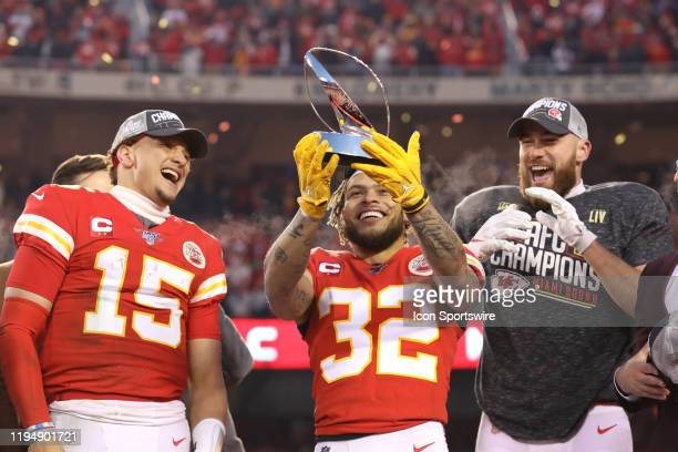 Kansas City Chiefs quarterback Patrick Mahomes strong safety Tyrann Mathieu and tight end Travis Kelce with the Lamar Hunt Trophy after the AFC...