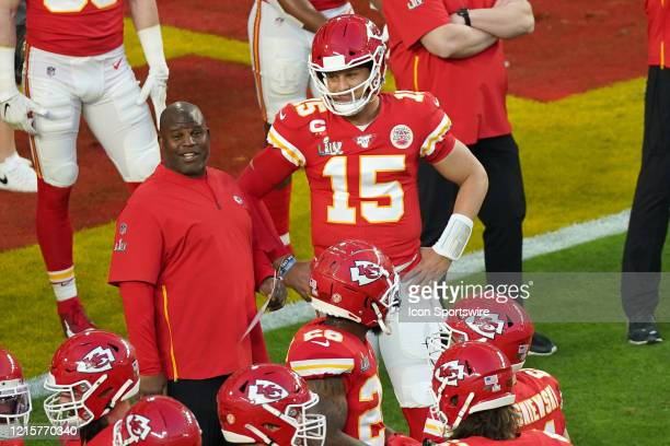 Kansas City Chiefs quarterback Patrick Mahomes talks with Kansas City Chiefs offensive coordinator Eric Bieniemy in game action during the Super Bowl...