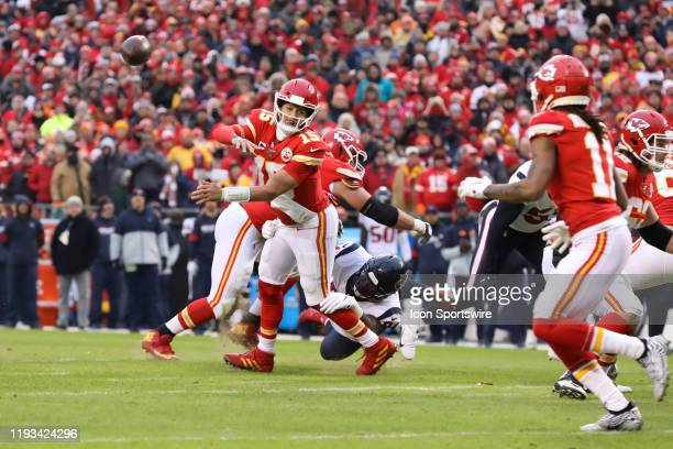 Kansas City Chiefs quarterback Patrick Mahomes throws a pass as Houston Texans defensive end Angelo Blackson dives at his feet in the second quarter...