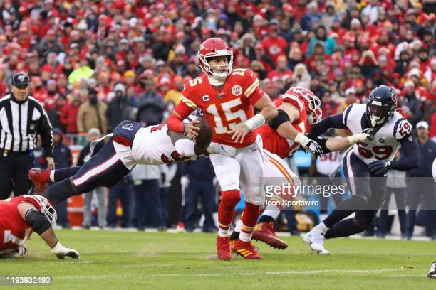 Kansas City Chiefs quarterback Patrick Mahomes throws a pass as Houston Texans defensive end Charles Omenihu dives to try and sack him in the second...