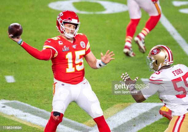Kansas City Chiefs Quarterback Patrick Mahomes throws the ball under pressure from San Francisco 49ers Defensive End Dee Ford during the NFL Super...