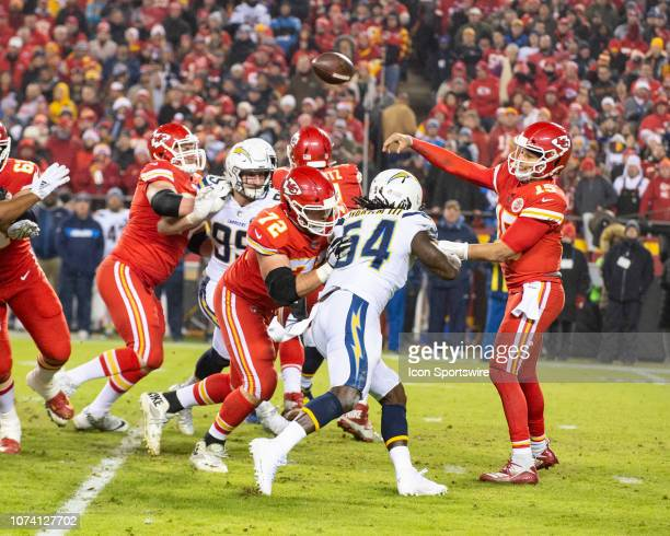 Kansas City Chiefs Quarterback Patrick Mahomes throws under pressure from Los Angeles Chargers Defensive End Melvin Ingram III and Los Angeles...