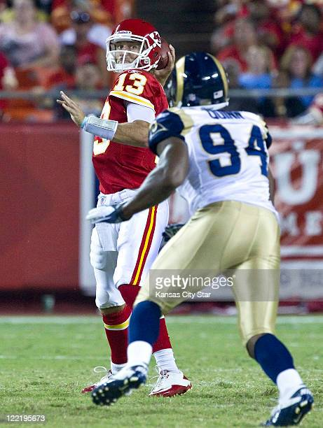 Kansas City Chiefs quarterback Ricky Stanzi throws over St Louis Rams defensive end Robert Quinn during the third quarter at Arrowhead Stadium in...