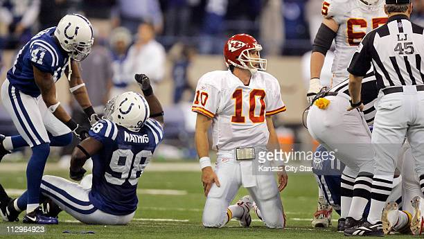 Kansas City Chiefs quarterback Trent Green can only look at the referee while Indianapolis Colts defensive end Robert Mathis celebrated his sack and...