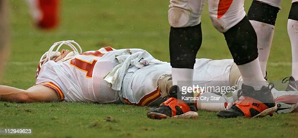 Kansas City Chiefs quarterback Trent Green lay motionless on the Arrowhead field turf after a hit on a scramble by Green in the third quarter against...