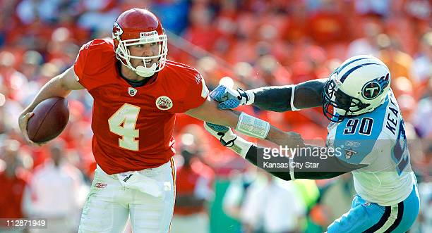 Kansas City Chiefs quarterback Tyler Thigpen is chased out of the pocket by Tennessee Titans defensive end Jevon Kearse during fourth quarter action...