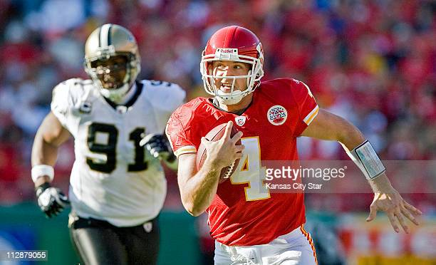 Kansas City Chiefs quarterback Tyler Thigpen races for a 32yard gain as he is chased by New Orleans Saints defensive end Will Smith in the fourth...