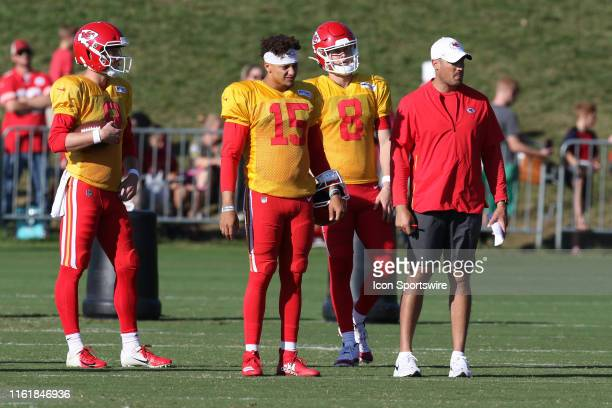 Kansas City Chiefs quarterbacks Patrick Mahomes and Chase Litton stand with coach Mike Kafka during Chiefs training camp on August 14 2019 at...