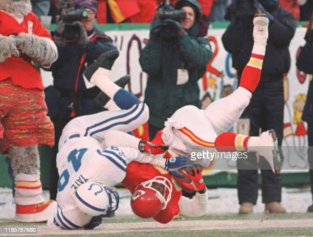 Kansas City Chiefs receiver Lake Dawson holds onto the ball for a 20yard touchdown reception as Indianapolis Colts safety David Tate tumbles with him...