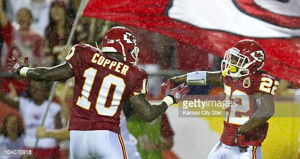 Kansas City Chiefs returner Dexter McCluster celebrates his 94-yard touchdown with teammate Terrance Copper in the second quarter against the San...