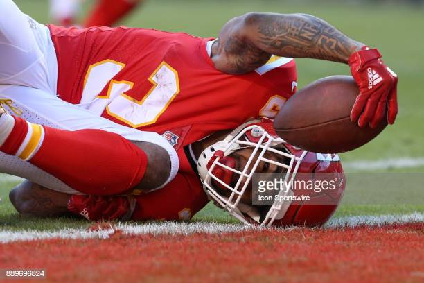 Kansas City Chiefs running back Charcandrick West crosses the goal line at the end of a 13yard touchdown run in the fourth quarter of an AFC West...