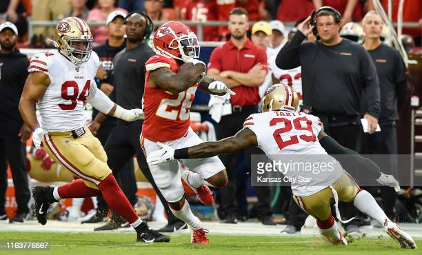 Kansas City Chiefs running back Damien Williams slipped past the defense of San Francisco 49ers defensive end Solomon Thomas, left, and strong safety...