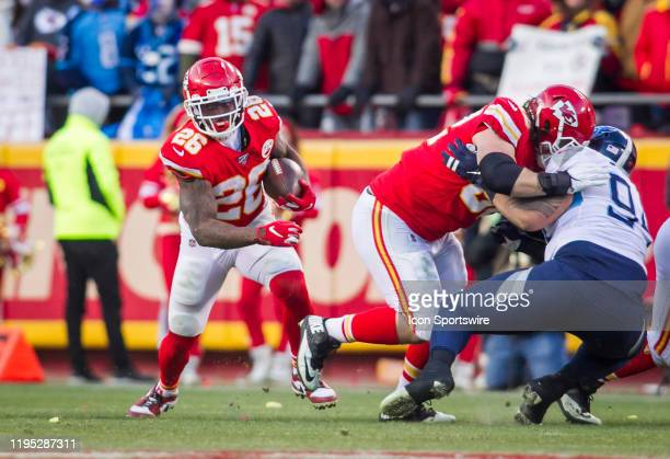 Kansas City Chiefs running back Damien Williams takes advantage of an opening created by a teammate during the AFC Championship game between the...