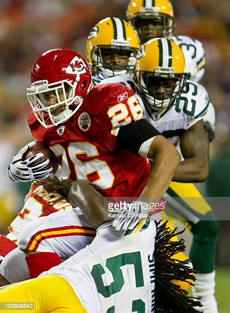 Kansas City Chiefs running back Jackie Battle is pulled down by Green Bay Packers linebacker Maurice Simpkins in the second quarter at Arrowhead...