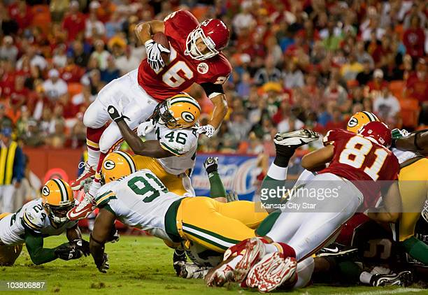 Kansas City Chiefs running back Jackie Battle tries to leap over Green Bay Packers safety Charlie Peprah near the goal line in the second quarter at...