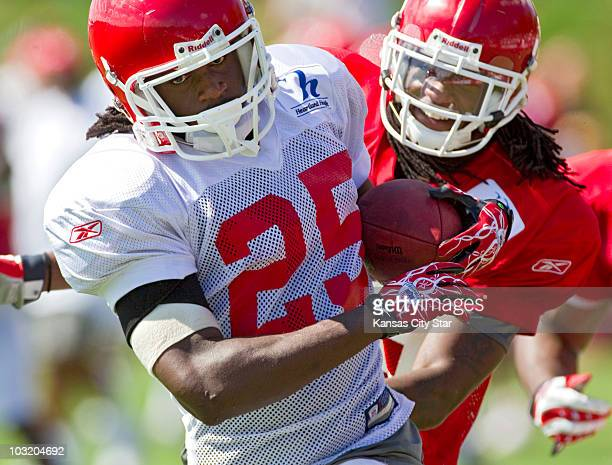 Kansas City Chiefs running back Jamaal Charles tries to stay ahead of safety Kendrick Lewis during training camp at Missouri Western State University...