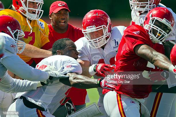 Kansas City Chiefs running back Javarris Williams, lower middle, clahses with linebacker Corey Mays, right, at practice on Tuesday, August 3 at the...