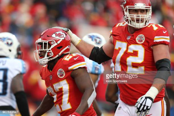 Kansas City Chiefs running back Kareem Hunt and offensive tackle Eric Fisher celebrate Hunt's 1yard touchdown run with 256 left in the first quarter...