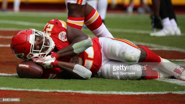 Kansas City Chiefs running back Kareem Hunt celebrates his 2yard touchdown run with a nap late in the fourth quarter of a week 2 NFL game between the...