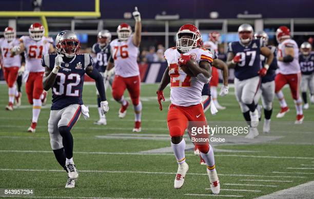 Kansas City Chiefs running back Kareem Hunt outruns the Patriots defense on a long gain for first down that set up the Chiefs' final touchdown before...