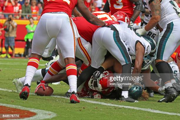 Kansas City Chiefs running back Kareem Hunt reaches the ball to the end zone through a pile of players for a 2yard touchdown run late in the fourth...