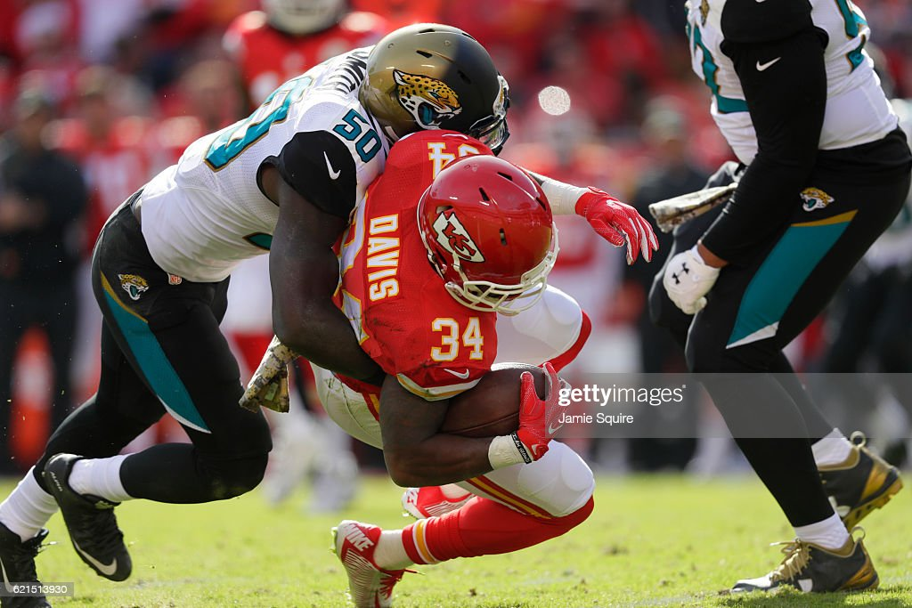 Kansas City Chiefs running back Knile Davis is tackled by outside linebacker Telvin Smith #50 of the Jacksonville Jaguars at Arrowhead Stadium during the second quarter of the game on November 6, 2016 in Kansas City, Missouri.