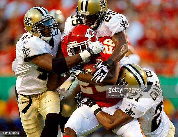 Kansas City Chiefs running back Michael Bennett is stopped by New Orleans Saints' Roman Harper Josh Bullock and cornerback Jason Craft in the first...