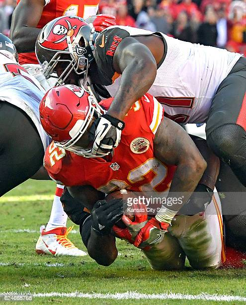 Kansas City Chiefs running back Spencer Ware is stopped at the one-yard line by Tampa Bay Buccaneers defensive end Robert Ayers with three minutes...