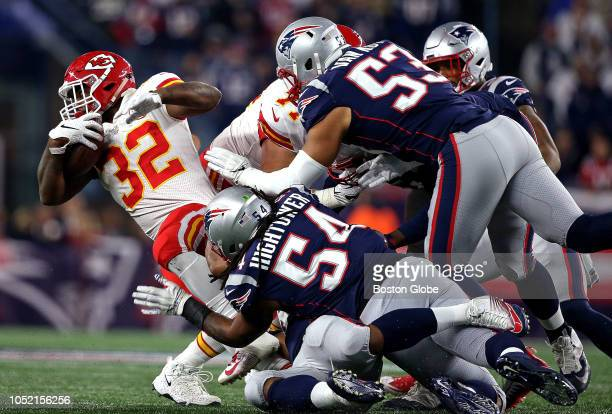 Kansas City Chiefs running back Spencer Ware is wrapped up by a host of New England Patriots defenders The New England Patriots host the Kansas City...