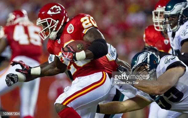 Kansas City Chiefs running back Thomas Jones is pulled down by Philadelphia Eagles linebacker Stewart Bradley in the second quarter at Arrowhead...