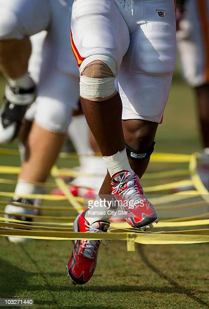 Kansas City Chiefs running back Thomas Jones practices footwork with his teammates by running through a fabric maze during practice at the team's...