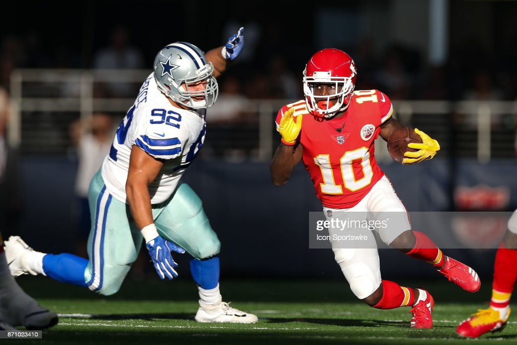 Kansas City Chiefs running back Tyreek Hill (10) rushes with the ball during the NFL game between the Kansas City Chiefs and Dallas Cowboys on November 5, 2017 at AT&T Stadium in Arlington, TX.
